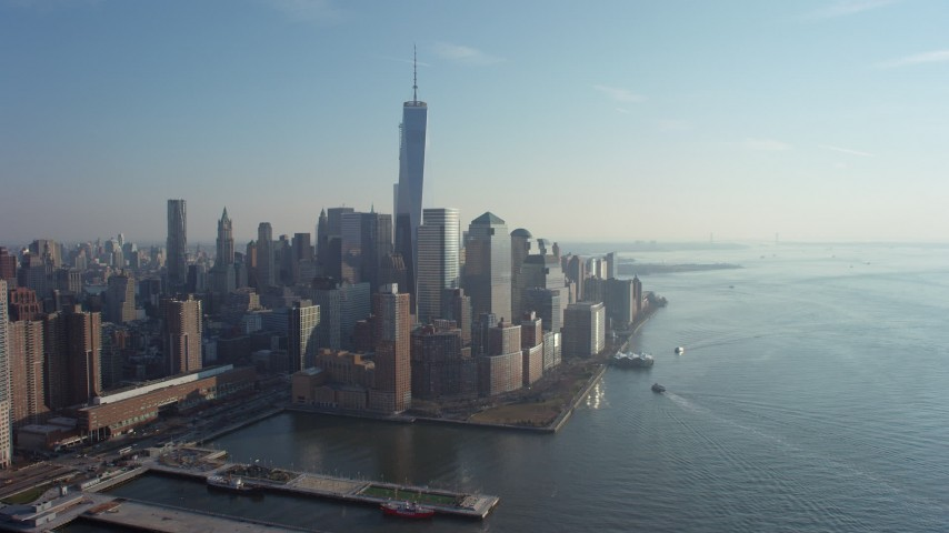 5K stock footage aerial video of flying by the World Trade Center skyscrapers in Lower Manhattan, New York City, winter Aerial Stock Footage | AX65_0092