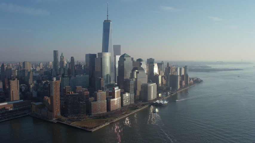 Passing by the World Trade Center skyscrapers in Lower Manhattan, New York City, winter Aerial Stock Footage | AX65_0093
