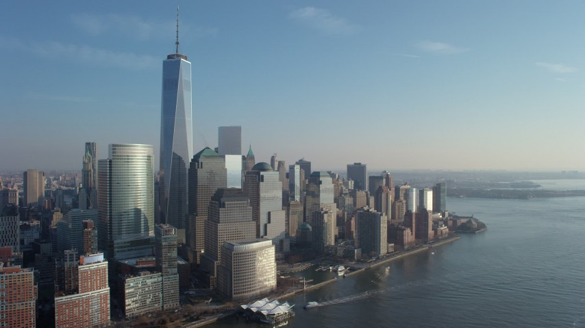 5K stock footage aerial video of Freedom Tower and World Trade Center skyscrapers in Lower Manhattan, New York City, winter Aerial Stock Footage | AX65_0094