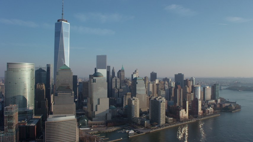5K stock footage aerial video of Freedom Tower and Lower Manhattan skyscrapers in New York City, winter Aerial Stock Footage | AX65_0095