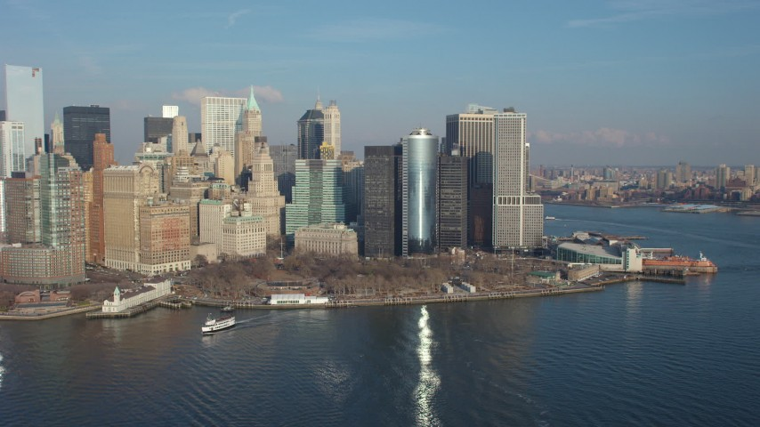 5K stock footage aerial video flyby Battery Park and Lower Manhattan skyline, reveal Freedom Tower, New York City, winter Aerial Stock Footage | AX65_0098