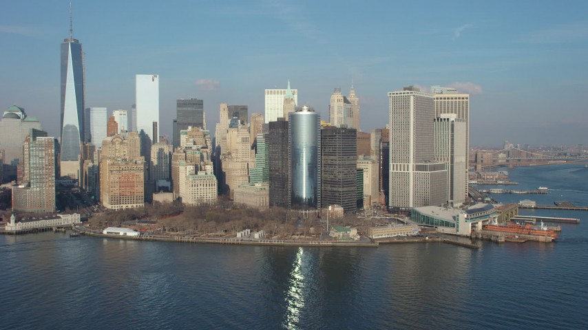Flyby Battery Park, Lower Manhattan skyline, and the Staten Island Ferry Terminal, New York City, winter Aerial Stock Footage | AX65_0099