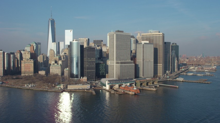 5K stock footage aerial video of Battery Park, the Lower Manhattan skyline, and the Staten Island Ferry Terminal, New York City, winter Aerial Stock Footage   AX65_0100
