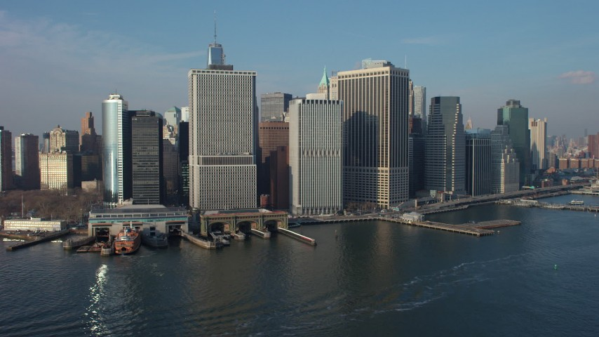 5K stock footage aerial video of Lower Manhattan skyline and the Staten Island Ferry Terminal on the East River, New York City, winter Aerial Stock Footage | AX65_0101