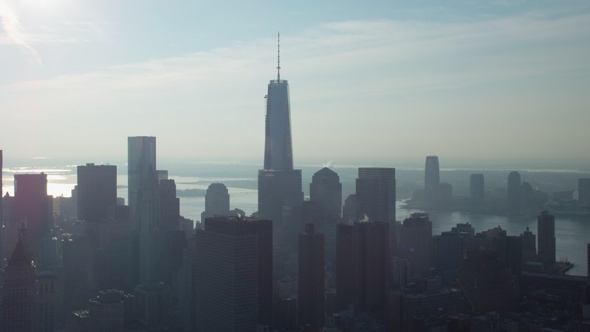 5K stock footage aerial video of One World Trade Center towering over Lower Manhattan high-rises and skyscrapers, New York City, winter Aerial Stock Footage | AX65_0108