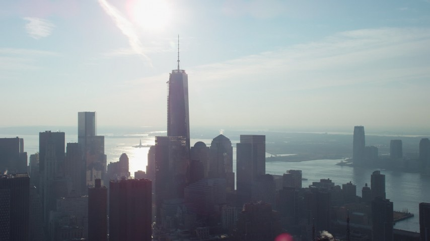 One World Trade Center towering over Lower Manhattan skyscrapers, New York City, winter Aerial Stock Footage | AX65_0109