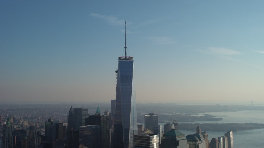 5K stock footage aerial video orbit the top of One World Trade Center in Lower Manhattan, New York City, winter Aerial Stock Footage | AX65_0112