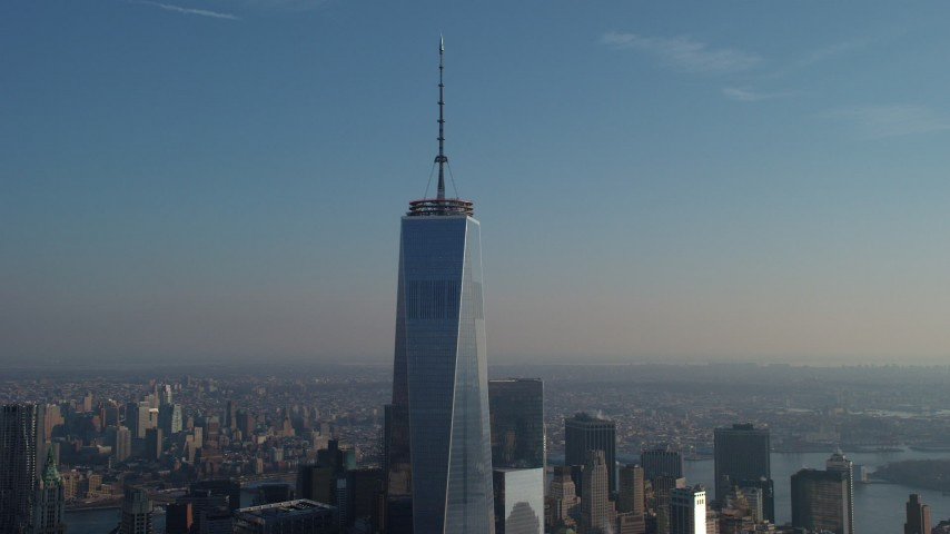 An orbit of Freedom Tower and top spire in Lower Manhattan, New York City, winter Aerial Stock Footage   AX65_0113