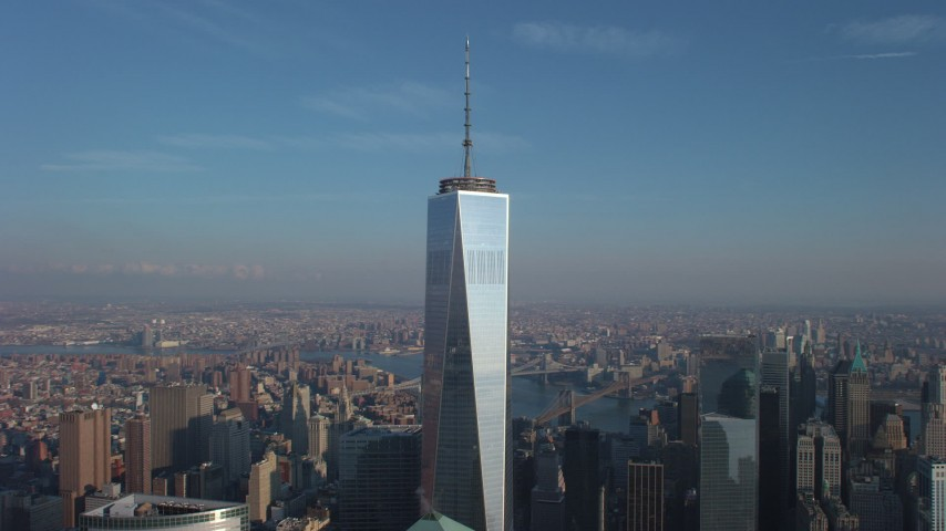 An orbit of Freedom Tower with the sun reflecting off the building in Lower Manhattan, New York City, winter Aerial Stock Footage AX65_0114