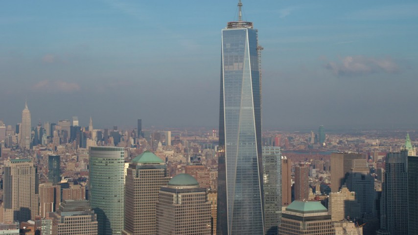5K stock footage aerial video tilt up to the spire atop Freedom Tower in Lower Manhattan, New York City, winter Aerial Stock Footage | AX65_0115