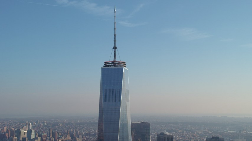 5K stock footage aerial video tilt down the side of Freedom Tower from the spire down the side in Lower Manhattan, New York City, winter Aerial Stock Footage   AX65_0122