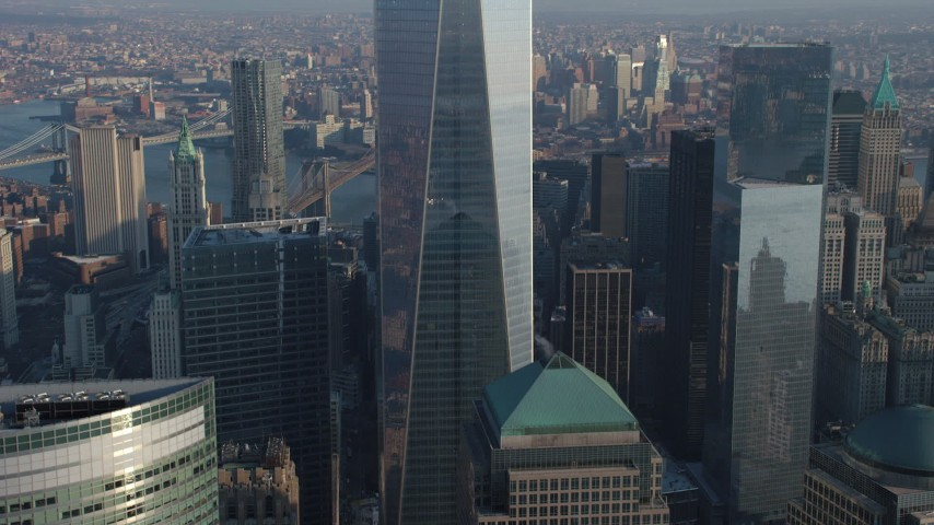 5K stock footage aerial video tilt down the side of Freedom Tower and reveal WTC skyscrapers in Lower Manhattan, New York City, winter Aerial Stock Footage | AX65_0123
