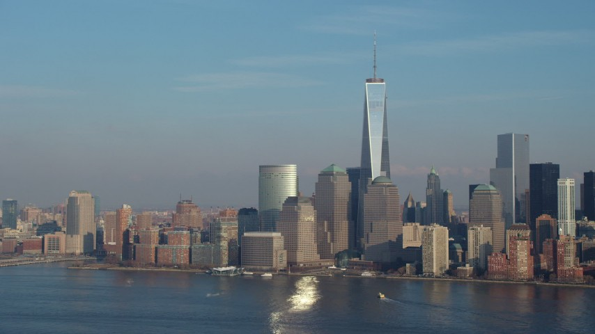 5K stock footage aerial video of Freedom Tower and the Lower Manhattan skyline, reveal Goldman Sachs Tower, New York City, winter Aerial Stock Footage | AX65_0126