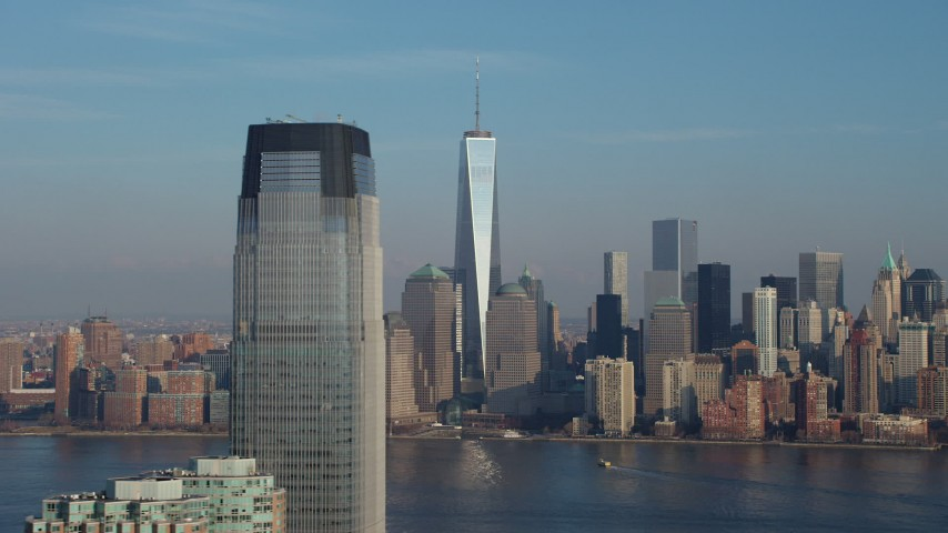 5K stock footage aerial video flyby Goldman Sachs Tower with Freedom Tower and Lower Manhattan skyline in the background, New York City, winter Aerial Stock Footage | AX65_0127