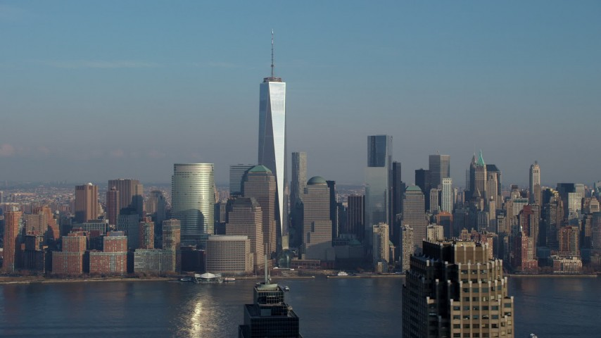 Freedom Tower and Lower Manhattan skyline seen from across the Hudson River, New York City, winter Aerial Stock Footage AX65_0128