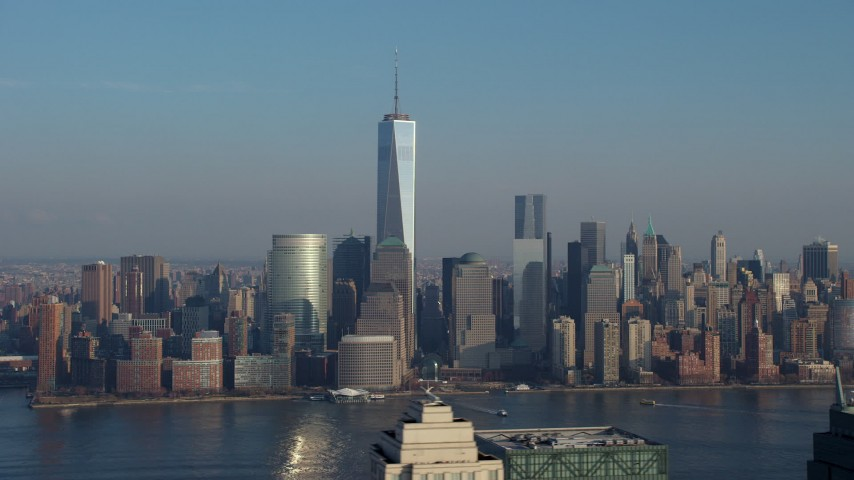 5K stock footage aerial video of One World Trade Center and Lower Manhattan skyline seen from across the Hudson River, New York City, winter Aerial Stock Footage | AX65_0129