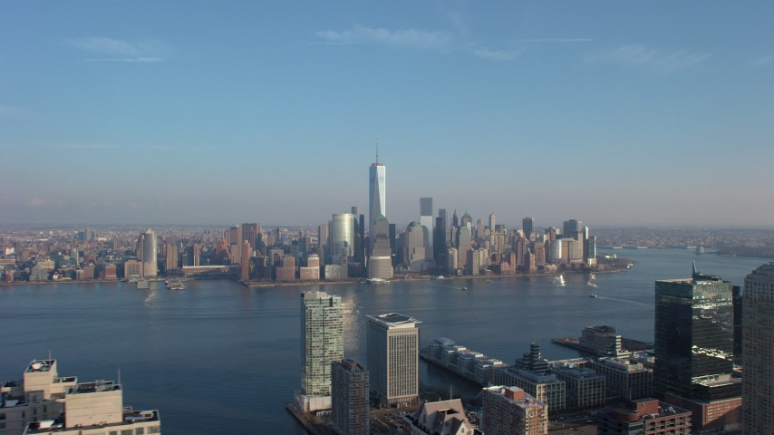 Lower Manhattan skyline seen from across the Hudson River, New York City, winter Aerial Stock Footage | AX65_0130