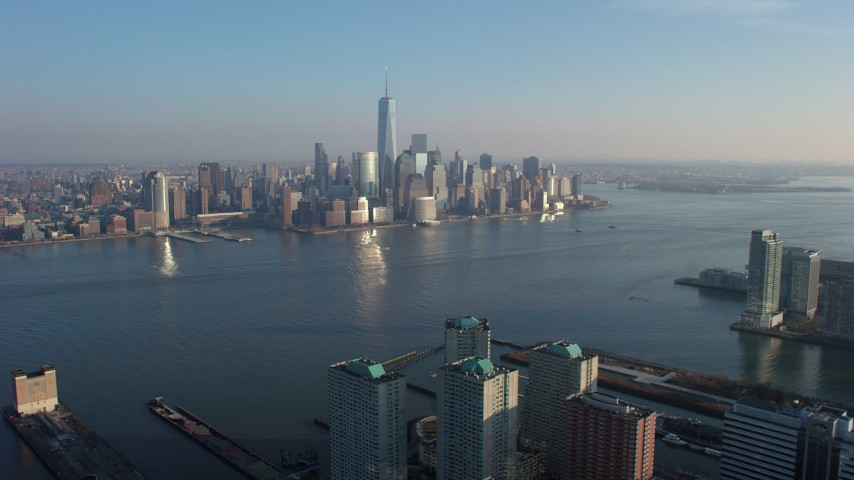 5K stock footage aerial video approach the Lower Manhattan skyline from across the Hudson River, New York City, winter Aerial Stock Footage | AX65_0132