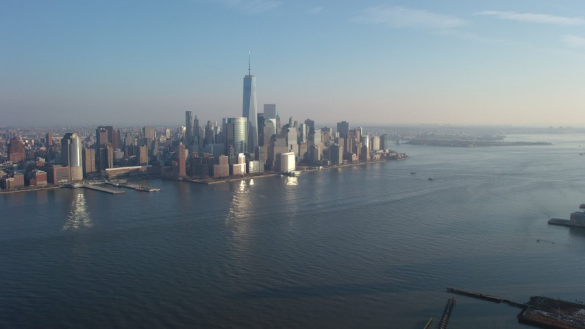 5K stock footage aerial video fly over Hudson River to approach the Lower Manhattan skyline, New York City, winter Aerial Stock Footage | AX65_0133