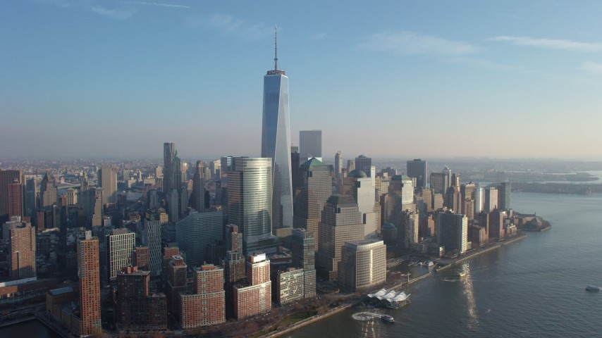 5K stock footage aerial video approach One World Trade Center and Lower Manhattan skyscrapers from the Hudson River, New York City, winter Aerial Stock Footage | AX65_0135