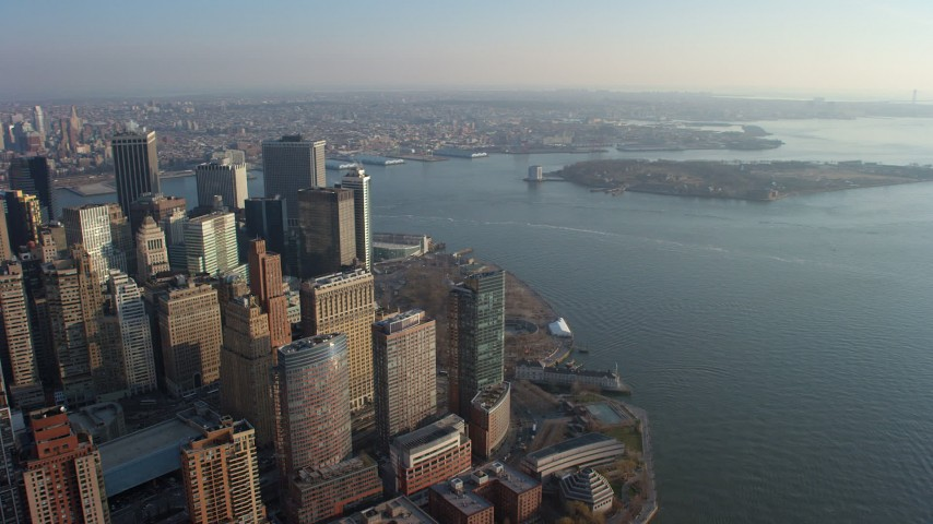 5K stock footage aerial video of Lower Manhattan skyscrapers and Battery Park in winter, New York City, winter Aerial Stock Footage | AX65_0137