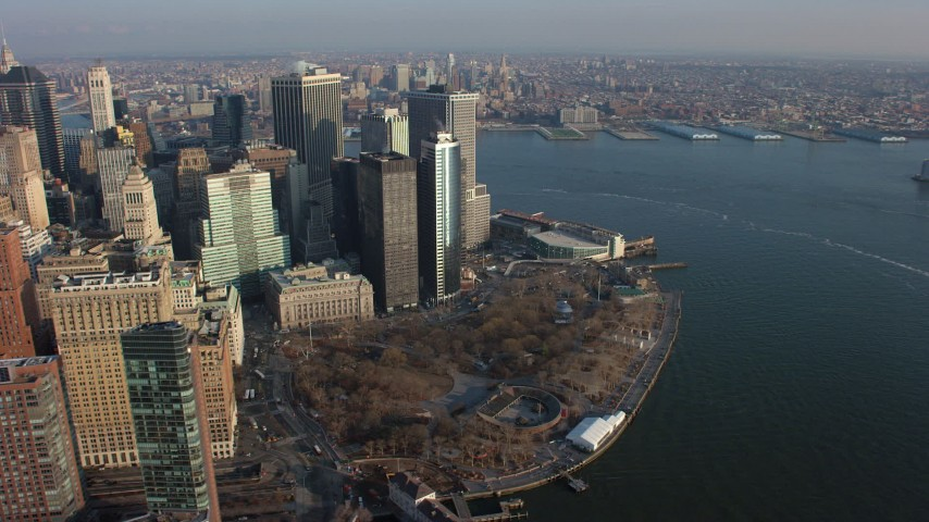 5K stock footage aerial video of flying by Lower Manhattan skyscrapers and Battery Park in winter, New York City, winter Aerial Stock Footage | AX65_0138