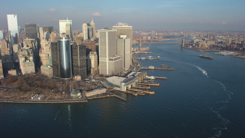 5K stock footage aerial video of Lower Manhattan skyscrapers, Battery Park, and the East River, New York City, winter Aerial Stock Footage | AX65_0140