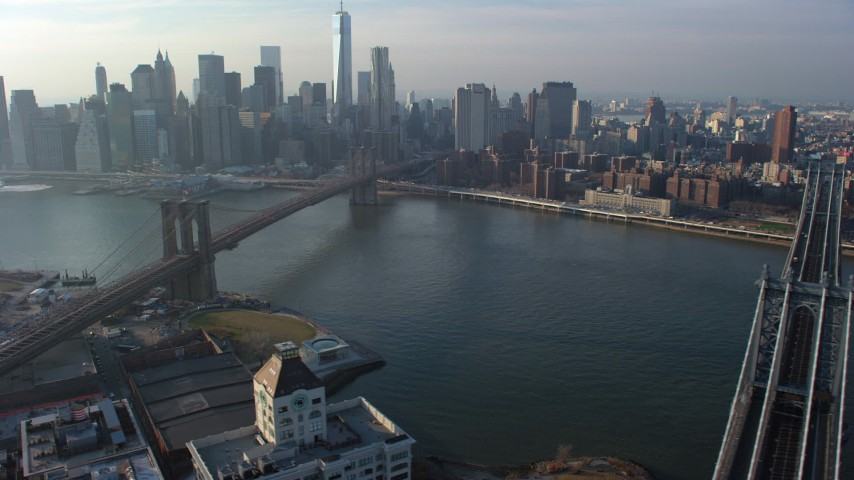 5K stock footage aerial video flyby the Manhattan Bridge with a view of the Lower Manhattan skyline and the Brooklyn Bridge, New York City, winter Aerial Stock Footage | AX65_0145