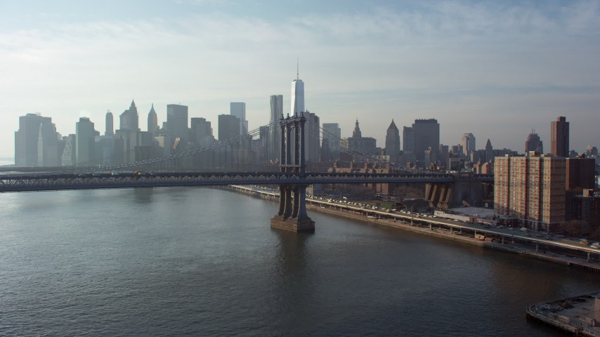 5K stock footage aerial video approach the Manhattan Bridge with the Lower Manhattan skyline in the background, New York City, winter Aerial Stock Footage | AX65_0147