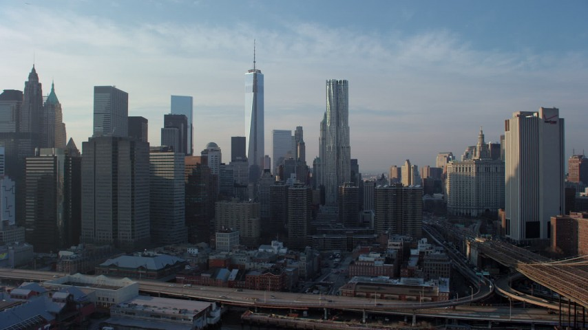 5K stock footage aerial video of a view of Freedom Tower, 8 Spruce Street skyscraper, and the Lower Manhattan skyline, New York City, winter Aerial Stock Footage | AX65_0151