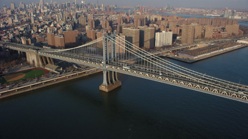 5K stock footage aerial video of light traffic crossing the Manhattan Bridge, New York City, winter Aerial Stock Footage | AX65_0154
