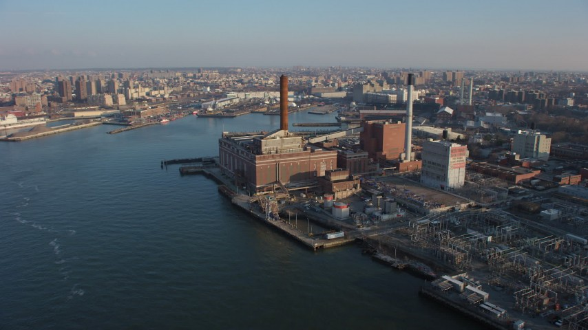 Riverfront power plant with smoke stacks in Brooklyn, New York City, winter Aerial Stock Footage | AX65_0155