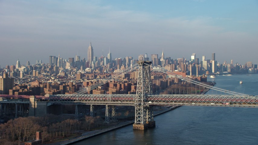 5K stock footage aerial video of light traffic on the Williamsburg Bridge, with Midtown Manhattan skyline in the background, New York City, winter Aerial Stock Footage | AX65_0157