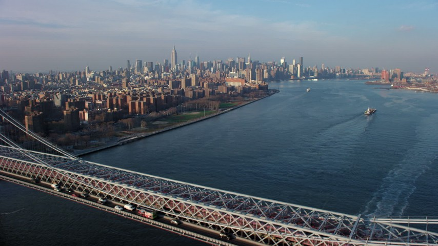5K stock footage aerial video fly over the Williamsburg Bridge toward Midtown Manhattan skyline in the background, New York City, winter Aerial Stock Footage | AX65_0158