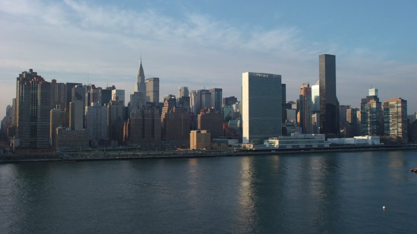 5K stock footage aerial video of United Nations and skyscrapers in Midtown Manhattan, New York City, winter Aerial Stock Footage | AX65_0165