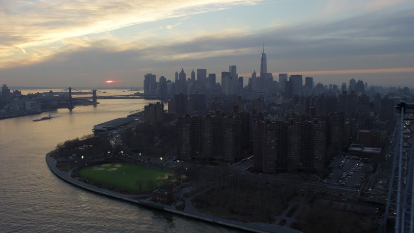 Lower Manhattan skyline seen from public housing on the Lower East Side, New York City, winter, sunset Aerial Stock Footage | AX65_0173