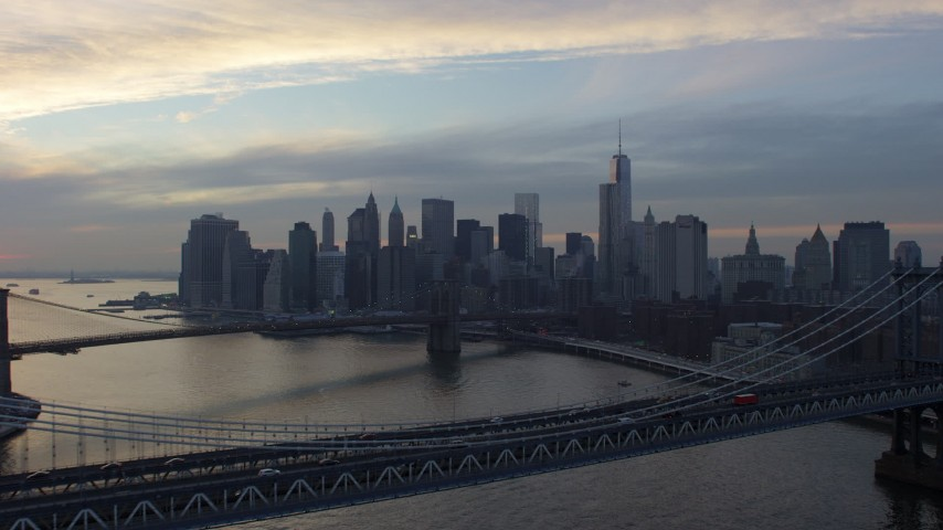 Approach the Brooklyn Bridge and Lower Manhattan skyline from Manhattan Bridge, New York City, winter, twilight Aerial Stock Footage | AX65_0177