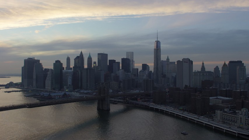 5K stock footage aerial video approach the Brooklyn Bridge and Lower Manhattan skyline, New York City, winter, twilight Aerial Stock Footage | AX65_0178
