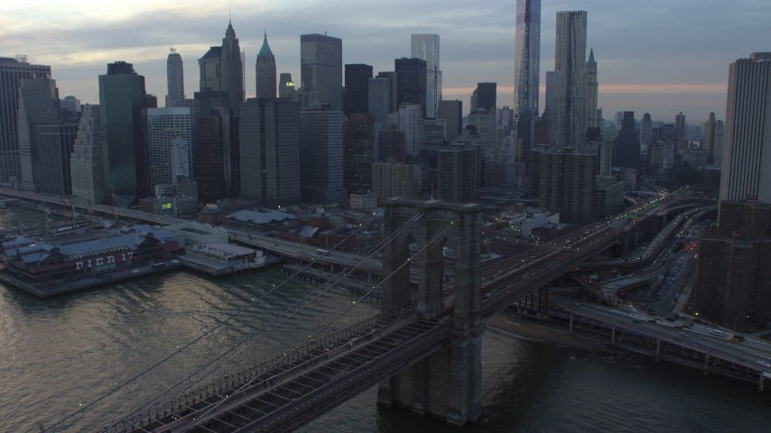 5K stock footage aerial video of tracking the Brooklyn Bridge with heavy traffic, New York City, winter, twilight Aerial Stock Footage | AX65_0179