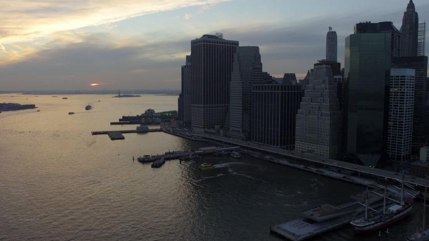 5K stock footage aerial video flyby riverfront skyscrapers and piers in Lower Manhattan, New York City, winter, twilight Aerial Stock Footage | AX65_0180