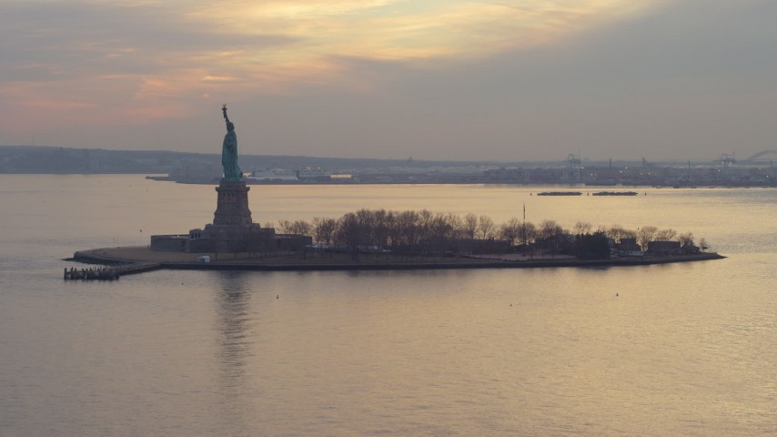 Flying by the Statue of Liberty in New York, winter, sunset Aerial Stock Footage | AX65_0183