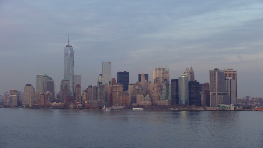5K stock footage aerial video approach the Lower Manhattan skyline from New York Harbor, New York City, winter, sunset Aerial Stock Footage | AX65_0190
