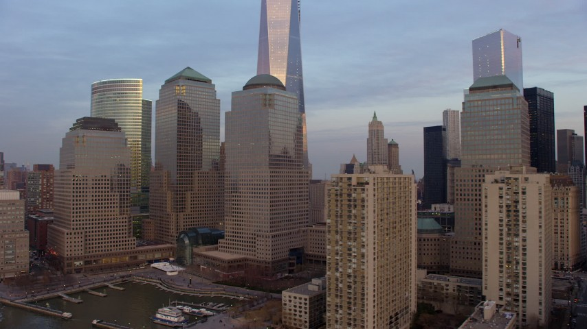 5K stock footage aerial video flyby World Trade Center skyscrapers  and tilt to the top of Freedom Tower in New York City, winter, sunset Aerial Stock Footage | AX65_0194