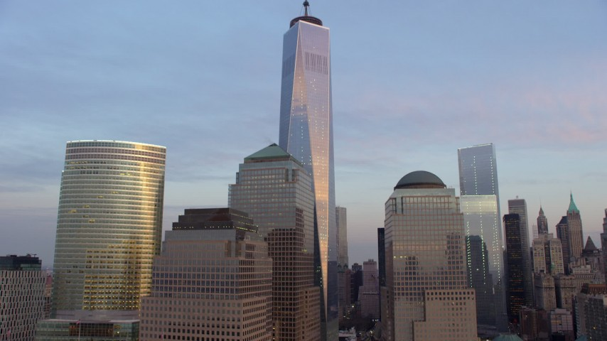 5K stock footage aerial video tilt up to the top of Freedom Tower in Lower Manhattan, New York City, winter, sunset Aerial Stock Footage | AX65_0195