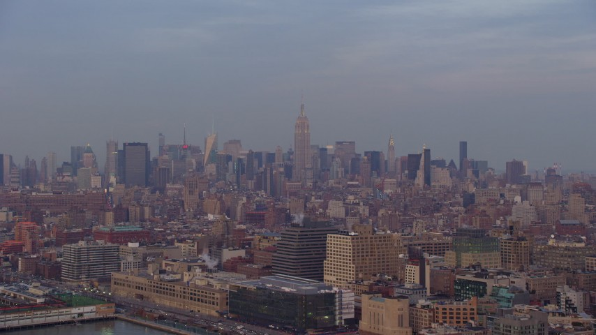 Midtown Manhattan skyline seen from Greenwich Village, New York City, winter, sunset Aerial Stock Footage | AX65_0196