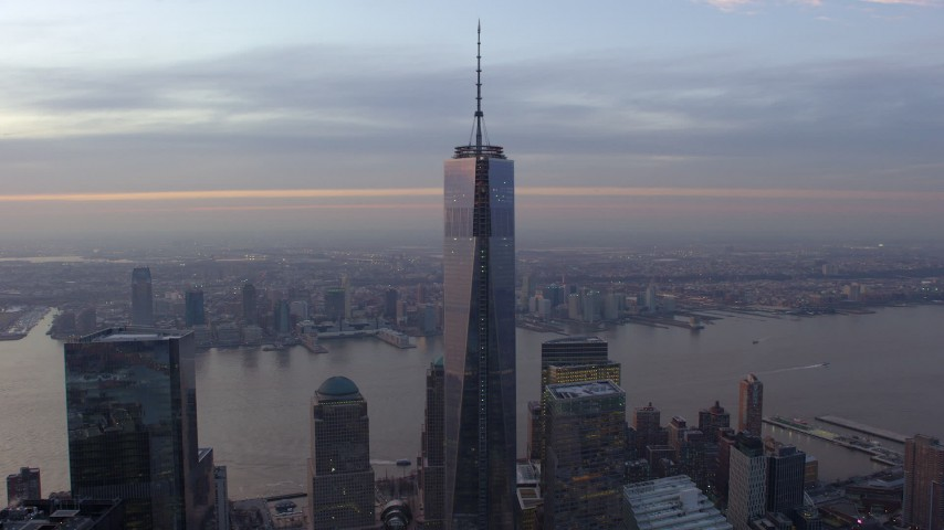 5K stock footage aerial video of orbiting Freedom Tower in Lower Manhattan with Hudson River in the background, New York City, winter, sunset Aerial Stock Footage | AX65_0203