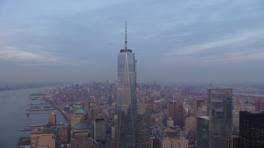 5K stock footage aerial video of an orbit of Freedom Tower in Lower Manhattan with Midtown in the background, New York City, winter, sunset Aerial Stock Footage | AX65_0205