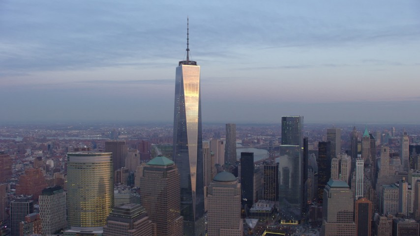 5K stock footage aerial video of orbiting One World Trade Center and high-rises in Lower Manhattan, New York City, winter, sunset Aerial Stock Footage | AX65_0207