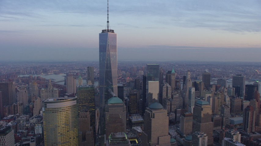 An orbit of One World Trade Center and high-rises in Lower Manhattan, New York City, winter, sunset Aerial Stock Footage | AX65_0208