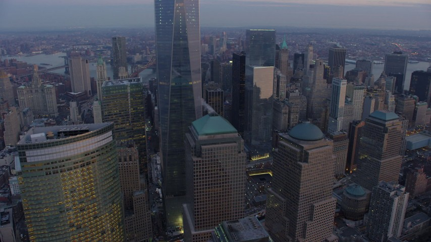 Flyby Two and Three World Financial Center in Lower Manhattan, New York City, winter, twilight Aerial Stock Footage | AX65_0210